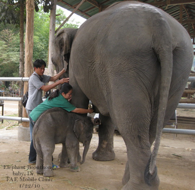Boonthong, her baby and Dr. Kay