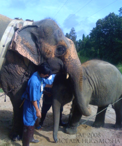 Motala hugs baby Mosha..Sept. 27, 2008