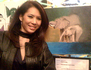 Miss Vachini Krairiksh and her painting