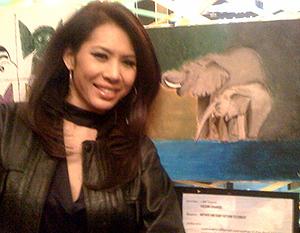 Miss Vachini Krairiksh and her painting